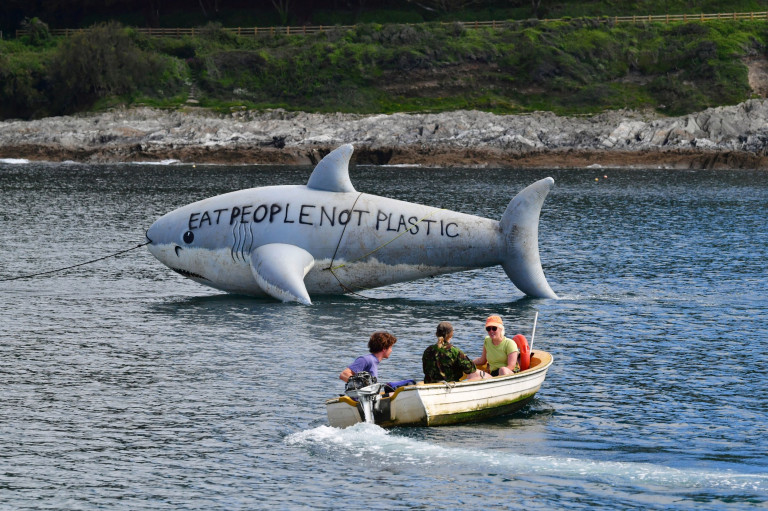 Environmental protesters with a large inflatable shark off the coast of Gylly Beach in Falmouth, during the G7 summit in Cornwall. Picture date: Saturday June 12, 2021. PA Photo. See PA story POLITICS G7. Photo credit should read: Ben Birchall/PA Wire