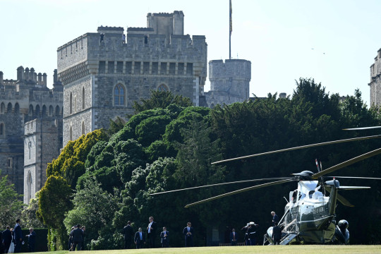 US President Joe Biden and US First Lady Jill Biden disembark from US helicopter Marine One at Windsor Castle in Windsor, west of London, on June 13, 2021. - US president Biden will visit Windsor Castle late Sunday, where he and First Lady Jill Biden will take tea with the queen. (Photo by Brendan SMIALOWSKI / AFP) (Photo by BRENDAN SMIALOWSKI/AFP via Getty Images)