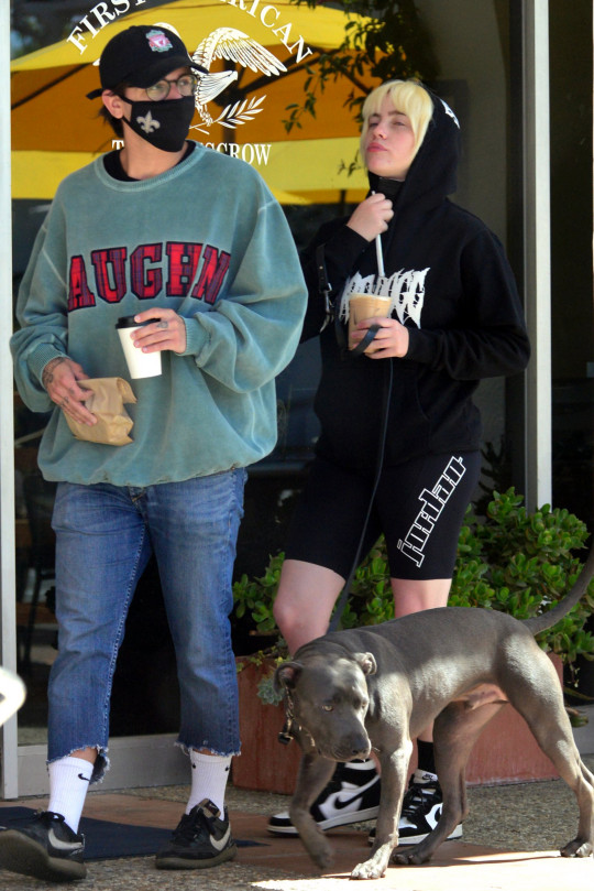 EXCLUSIVE: **EMBARGO: STRICTLY NO WEB UNTIL TUESDAY, APRIL 20TH 11AM PST (LA Time) FEE For Online After Embargo 400 GBP For Set ** * Min Print FeesTBA * Singer Billie Eilish gets cozy with her new actor beau as the two are spotted grabbing coffees and taking her beloved pit bull 'Shark' for a walk during a California staycation. The newly blonde hitmaker, 19, was seen nuzzling into dark haired actor Matthew Tyler Vorce, who seems to be both a Liverpool F.C. fan as well as a supporter of the New Orleans Saints NFL team. The pair, who matched super casual looks for their mid morning outing, looked to be very much into each other as they cozied up in front of onlookers while waiting for their order at a coffee shop. Tattooed Vorce, who has appeared in three movies, wore a Vaughn sweatshirt while the pop megastar kept it casual in sneakers and a black Snoop Dogg hoodie. The two are understood to have been enjoying a luxury break by themselves at a plush villa in Santa Barbara. Vorce describes himself as a LA-based 'actor, writer, degenerate' on his Instagram profile and sports an angel tattoo on his hand, as well as the word 'GYPSY' spelled out on his fingers. According to his IMDB.com acting profile, the 29-year-old is known for his roles in 'Mother, May I Sleep with Danger?' (2016), 'Little Monsters' (2012) and 'Dark Hours: Typee' (2016). Pictured: Billie Eilish,Matthew Vorce Ref: SPL5221881 160421 EXCLUSIVE Picture by: Ronin47 / SplashNews.com **EMBARGO: STRICTLY NO WEB UNTIL TUESDAY, APRIL 20TH 11AM PST (LA Time) FEE For Online After Embargo 400 GBP For Set ** * Min Print FeesTBA * Splash News and Pictures USA: +1 310-525-5808 London: +44 (0)20 8126 1009 Berlin: +49 175 3764 166 photodesk@splashnews.com World Rights