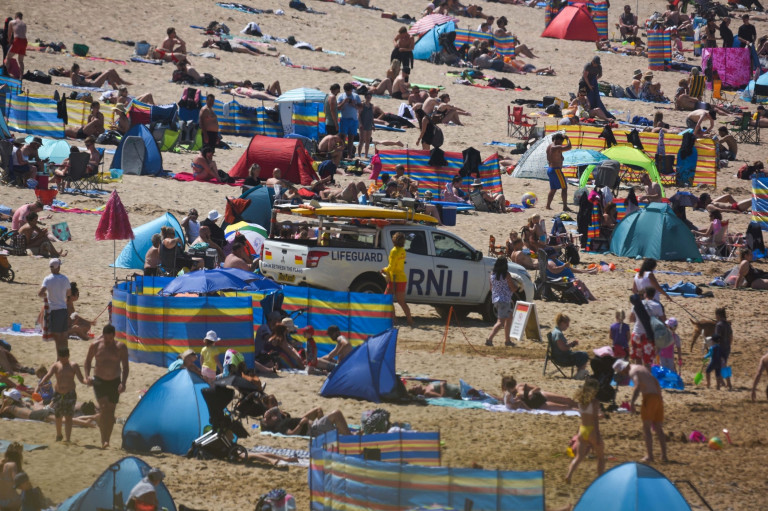 People packed on to the beach at Fistral in Cornwall