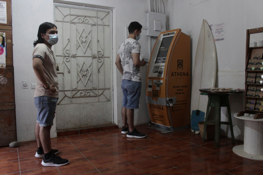 The first ATM designed to withdraw cash through the cryptocurrency app 'Bitcoin Beach' has been installed on El Zonte Beach in Tamanique, El Salvador. (Credits: AP)