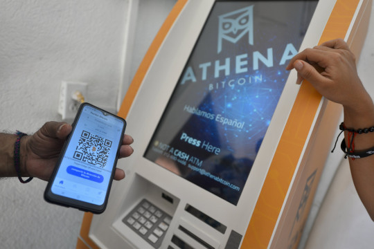 A person scans a QR code at the Bitcoin ATM (Getty)