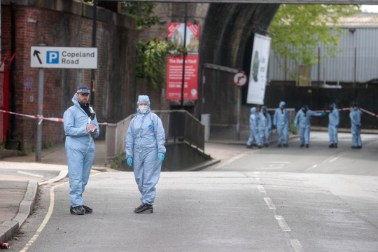 Forensic officers stand at the area after Sasha Johnson, a BLM activist, was shot in an early morning attack near her home in Peckham, London, Britain, May 24, 2021. REUTERS/Hannah McKay