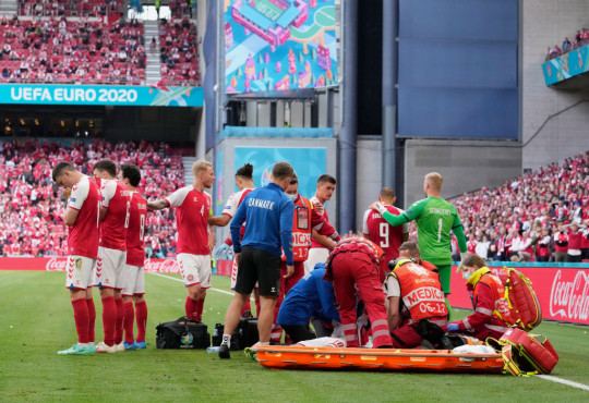 Christian Eriksen on the floor after his collapse in Denmark's Euro 2020 opener with FInland