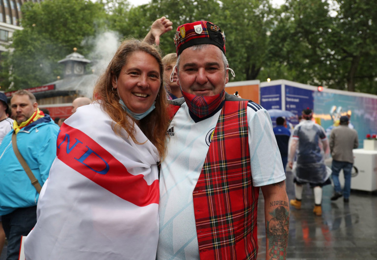Scotland and England fans gather in Leicester Square before the UEFA Euro 2020 match between England and Scotland later tonight. Picture date: Friday June 18, 2021. PA Photo. See PA story SOCCER England. Photo credit should read: Kieran Cleeves/PA Wire. RESTRICTIONS: Use subject to restrictions. Editorial use only, no commercial use without prior consent from rights holder.