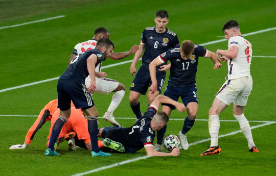Armstrong of Scotland scramble the ball with Declan Rice of England during the UEFA Euro 2020 Championship Group D match between England and Scotland at Wembley Stadium