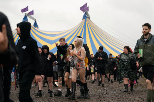 Festivalgoers on the first day of Download Festival at Donington Park in Leicestershire. Picture date: Friday June 18, 2021. PA Photo. The three-day festival is being held as a test event to examine how Covid-19 transmission takes place in crowds, with the the capacity significantly reduced from 111,000 to just 10,000. See PA story SHOWBIZ Download. Photo credit should read: Joe Giddens/PA Wire