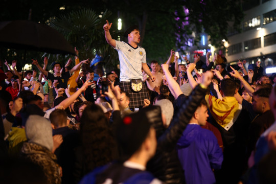 Soccer Football - Euro 2020 - Fans gather for England v Scotland - London, Britain - June 18, 2021 Scotland fans celebrate in London after the match REUTERS/Henry Nicholls