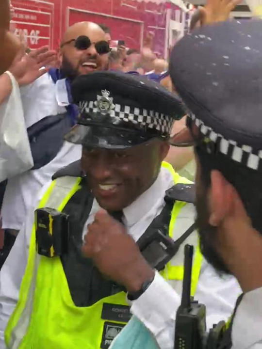 Officers were seen laughing and joking with the crowds