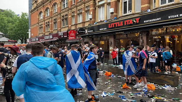 Litter fills the streets around Leicester Square as fans gather for crunch Euro match