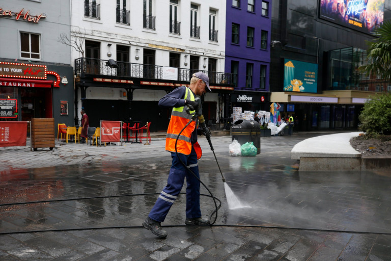 Cleaner jet washing the concrete in Leicester Square. London's cleaners will spend today cleaning Leicester Square after Scottish football fans took over the West End before and after the Euro 2020 game.
