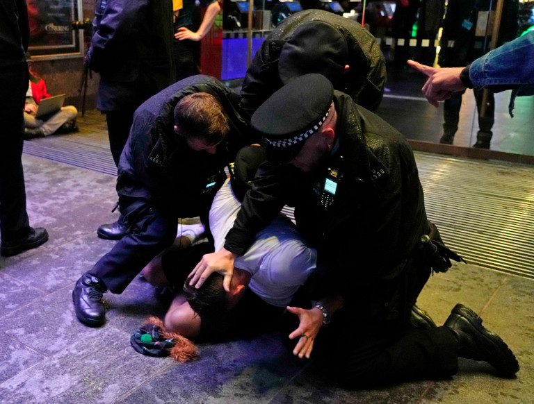 Police arresting a Scottish fan.  London's cleaners will spend today cleaning Leicester Square after Scottish football fans took over the West End before and after the Euro 2020 game.