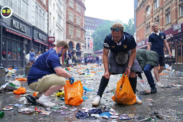 Scottish fans helping to clean up the mess. London's cleaners will spend today cleaning Leicester Square after Scottish football fans took over the West End before and after the Euro 2020 game.