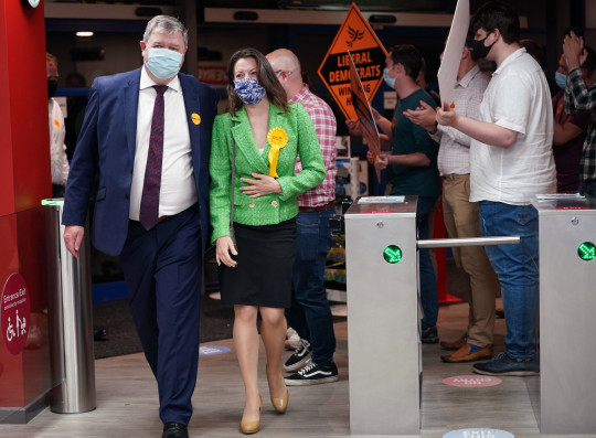 Liberal Democrat candidate Sarah Green and Alistair Carmichael, Liberal Democrat MP for Orkney and Shetland, are greeted by party supporters upon arriving for the declaration in the Chesham and Amersham by-election at Chesham Leisure Centre in Chesham, Buckinghamshire. Picture date: Friday June 18, 2021. PA Photo. Chesham and Amersham has had just two MPs in its history, Sir Ian Gilmour until 1992, and former Welsh secretary Dame Cheryl Gillan until her death in April. See PA story POLITICS Chesham. Photo credit should read: Yui Mok/PA Wire