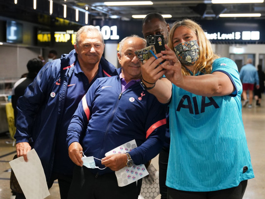 (left to right) Former Tottenham Hotspur's players Gary Mabbutt, Ossie Ardiles and Ledley King, pose for a photograph with a woman who has been vacinated at an NHS Vaccination Clinic at Tottenham Hotspur's stadium in north London. The NHS is braced for high demand as anyone in England over the age of 18 can now book a Covid-19 vaccination jab. Picture date: Sunday June 20, 2021. PA Photo. See PA story HEALTH Coronavirus. Photo credit should read: Yui Mok/PA Wire