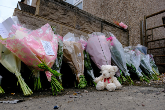Floral tributes left at the scene on Endon Road in Stoke on Trent where a driver mounted the pavement and collided with a father and his 6 year old daughter, who was sadly died after being mown down by the car. June 20 2021. See SWNS story SWMDstoke. A six-year-old girl has tragically died after she and her father were struck by a car while out walking last night (sat). The young girl were struck by a car last night (19/6) at around 7.15pm. Staffordshire Police are now appealing for any witnesses to the incident which happened on Endon Road, Norton Green, Stoke-on-Trent. Despite the best efforts of passers-by the girl, aged six was pronounced dead at the scene.