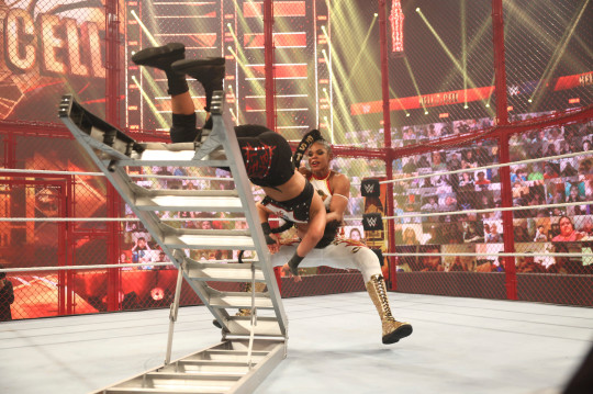 SmackDown Women's Champion Bianca Belair hits Bayley with the KOD onto a ladder at WWE Hell In A Cell in June 2021