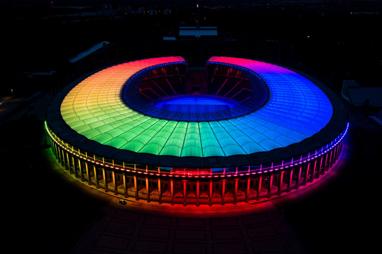 BERLIN, GERMANY - JUNE 23: In this aerial view the Olympiastadion stadium stands illuminated in LGBT rainbow colors on June 23, 2021 in Berlin, Germany. Stadiums and landmarks across Germany are being illuminated with rainbow colors to coincide with tonight's UEFA Euro 2020 match between Germany and Hungary. The Hungarian government recently passed a law banning LGBT people from appearing in school educational materials and children's TV shows. UEFA denied a request from the mayor of Munich to illuminate Allianz Arena, the venue for tonight's match, in rainbow colors, citing the political motive of the request. (Photo by Jan-Philipp Burmann/City-Press via Getty Images)