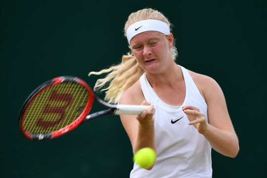 Britain's Francesca Jones plays a girls doubles match against US Amanda Anisimova and US Alexandra Sanford on the eleventh day of the 2016 Wimbledon Championships at The All England Lawn Tennis Club in Wimbledon, southwest London, on July 7, 2016.