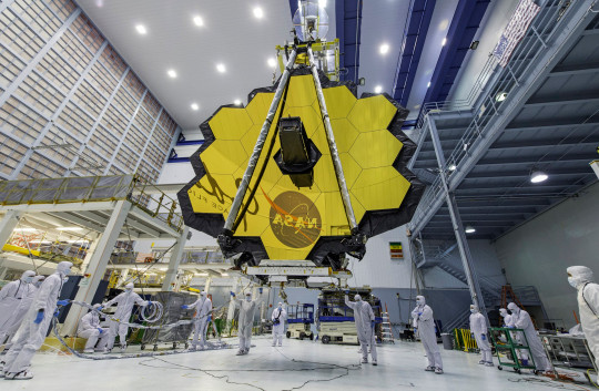 Technicians lift the mirror of the James Webb Space Telescope using a crane at the Goddard Space Flight Center in the USA