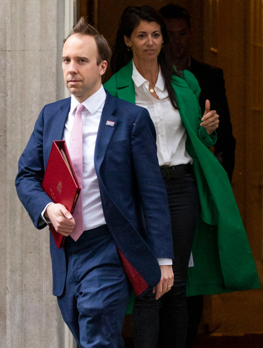 LONDON, ENGLAND - MAY 01: Health Secretary Matt Hancock followed by Gina Coladangelo, aide to the Health Secretary and Non-Executive Director at the Department of Health and Social Care, leave 10 Downing Street after the daily press briefing on May 01, 2020 in London, England. Mr Hancock announced that the government's pledge to conduct 100,000 Covid-19 tests per day had been successful. British Prime Minister Boris Johnson, who returned to Downing Street this week after recovering from Covid-19, said the country needed to continue its lockdown measures to avoid a second spike in infections. (Photo by Dan Kitwood/Getty Images)