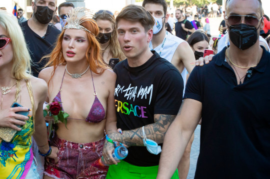 Superstar Bella Thorne and her fiance, musician Benjamin Mascolo in the crowd at Milan's Pride event