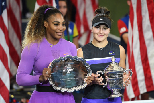 Bianca Andreescu (R) of Canada celebrates with the championship trophy alongside runner up Serena Williams (L) of the United States during the trophy presentation ceremony after the Women's Singles final on day thirteen of the 2019 US Open at the USTA Billie Jean King National Tennis Center on September 07, 2019 in the Queens borough of New York City.