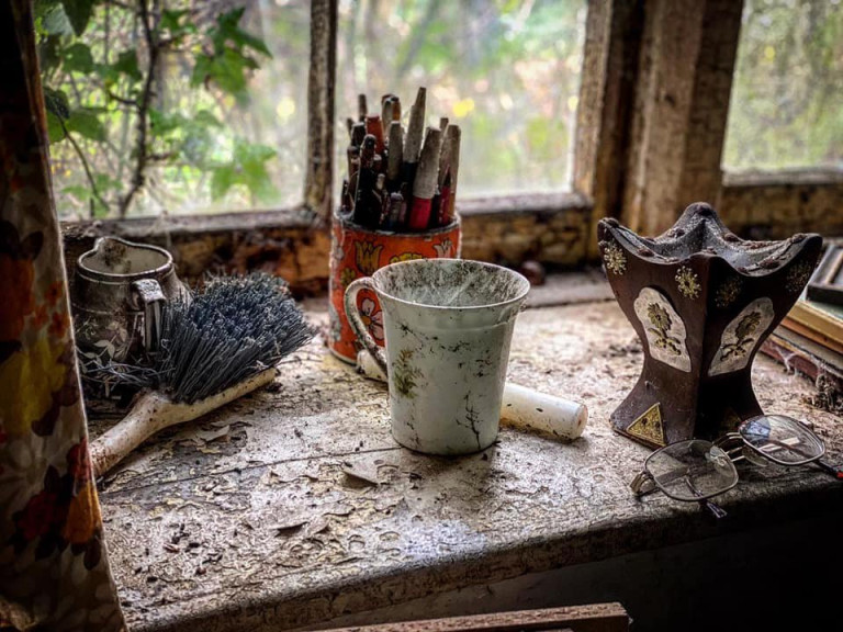 DEVON, UK: Dust and mould has taken over the space. THE MOMENT an urban explorer comes across an abandoned cottage full of photo slides of tribal communities taken from around the world and dusty old books has been captured on camera. One photo from the exploration showed the living room of the house, crammed full of wooden stalls, a television from the 1990s and a cast-iron log burner. In a second picture a fascinating set of photo slides from the former owner?s travels to the far east could be seen. In another, photos of what appeared to be the occupant?s grandchildren and pets could be seen on the mantelpiece of the property. The Devon-based abandoned cottage was visited by former plumber turned full time urban explorer Colin Smith (36) from Hampshire, UK who goes by the name The Urban Explorer on YouTube. From the labels on old food, Colin estimated that the property has been left abandoned for at least 20 years. Mediadrumworld.com/Colin Smith