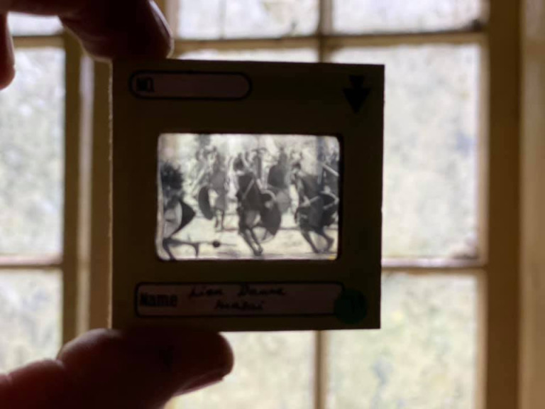 DEVON, UK: Old film slides show pictures from around the world. THE MOMENT an urban explorer comes across an abandoned cottage full of photo slides of tribal communities taken from around the world and dusty old books has been captured on camera. One photo from the exploration showed the living room of the house, crammed full of wooden stalls, a television from the 1990s and a cast-iron log burner. In a second picture a fascinating set of photo slides from the former owner?s travels to the far east could be seen. In another, photos of what appeared to be the occupant?s grandchildren and pets could be seen on the mantelpiece of the property. The Devon-based abandoned cottage was visited by former plumber turned full time urban explorer Colin Smith (36) from Hampshire, UK who goes by the name The Urban Explorer on YouTube. From the labels on old food, Colin estimated that the property has been left abandoned for at least 20 years. Mediadrumworld.com/Colin Smith