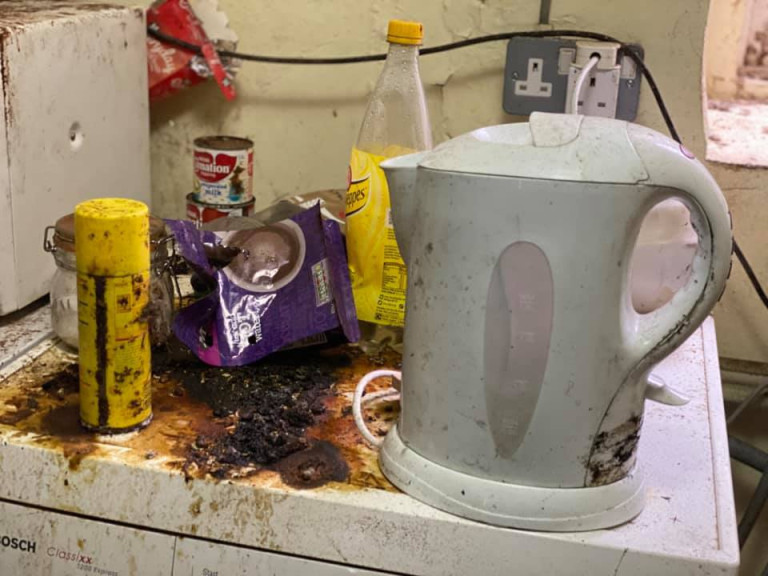DEVON, UK: The property's tea making facilities have seen better days. THE MOMENT an urban explorer comes across an abandoned cottage full of photo slides of tribal communities taken from around the world and dusty old books has been captured on camera. One photo from the exploration showed the living room of the house, crammed full of wooden stalls, a television from the 1990s and a cast-iron log burner. In a second picture a fascinating set of photo slides from the former owner?s travels to the far east could be seen. In another, photos of what appeared to be the occupant?s grandchildren and pets could be seen on the mantelpiece of the property. The Devon-based abandoned cottage was visited by former plumber turned full time urban explorer Colin Smith (36) from Hampshire, UK who goes by the name The Urban Explorer on YouTube. From the labels on old food, Colin estimated that the property has been left abandoned for at least 20 years. Mediadrumworld.com/Colin Smith