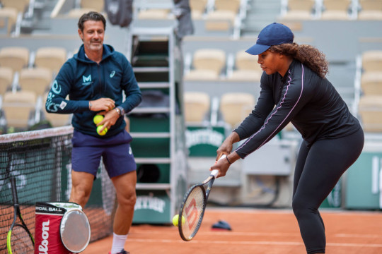 Serena Williams of the United States practicing with coach Patrick Mouratoglou while training on Court Philippe-Chatrier in preparation for the 2021 French Open Tennis Tournament at Roland Garros on May 29th 2021 in Paris, France.