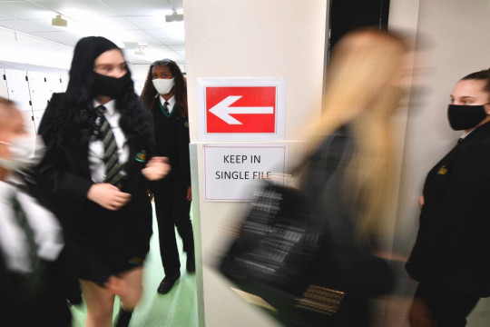 Social distancing signs are displayed in the corridors at Copley Academy on March 09, 2021 in Manchester, England.