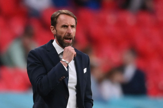 England manage Gareth Southgate calling out instructions from the side of the pitch.