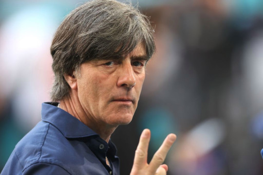 German head coach Joachim Low giving instructions on the pitch.