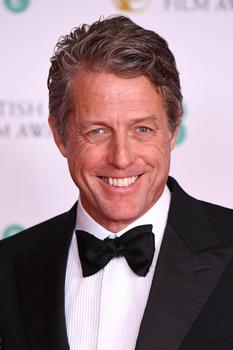 Presenter Hugh Grant attends the EE British Academy Film Awards 2021 at the Royal Albert Hall on April 11, 2021 in London, England