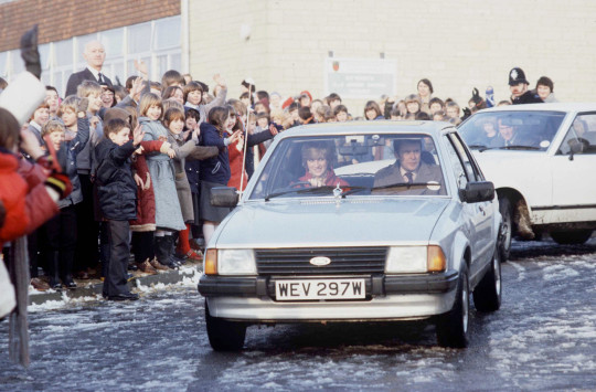 Princess Diana Driving Her Ford Escort Car On A Visit To St Mary's School In Tetbury. In The Passenger Seat Is Her Police Bodyguard Graham Smith (Photo by Tim Graham Photo Library via Getty Images)