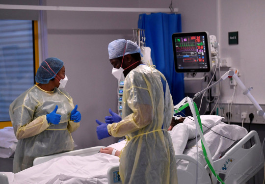Nurses react as they treat a COVID-19 patient in the ICU (Intensive Care Unit) at Milton Keynes University Hospital. The number of people with coronavirus in hospital and on ventilators is at the highest its been in more than two months.