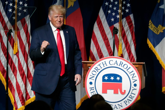 Former President Donald Trump acknowledges the crowd as he speaks at the North Carolina Republican Convention Saturday, June 5, 2021, in Greenville, N.C. (AP Photo/Chris Seward)