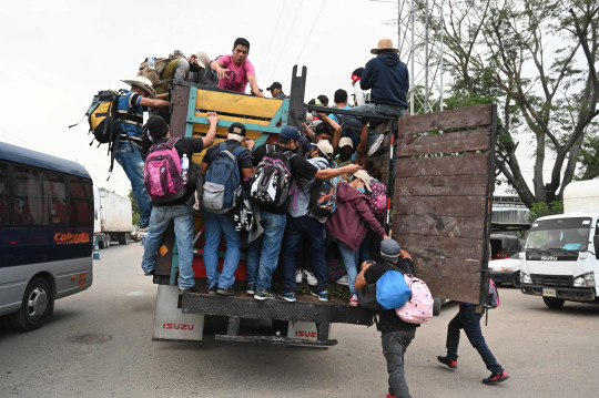 Honduran migrants move to Agua Caliente, on the border between Honduras and Guatemala, on their way to the United States, on January 15, 2021. - Hundreds of asylum seekers are forming new migrant caravans in Honduras, planning to walk thousands of kilometers through Central America to the United States via Guatemala and Mexico, in search of a better life under the new administration of President-elect Joe Biden. (Photo by Orlando SIERRA / AFP) (Photo by ORLANDO SIERRA/AFP via Getty Images)