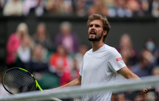 Germany's Oscar Otte after losing a point to Britain's Andy Murray during the men's singles second round match on day three of the Wimbledon Tennis Championships