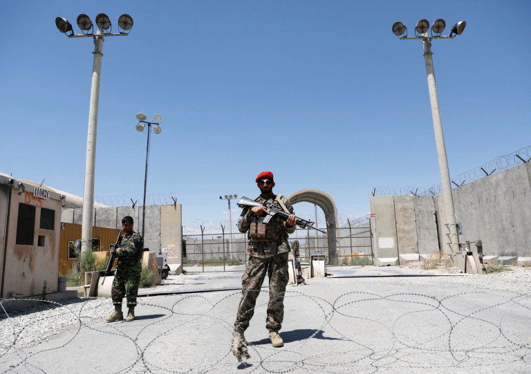 Afghan soldiers stand guard at the gate of Bahram U.S. air base, on the day the last American troops vacated it, Parwan province, Afghanistan July 2, 2021. REUTERS/Mohammad Ismail