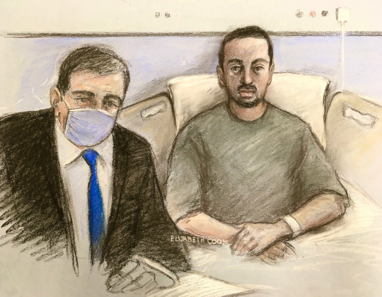 Court artist sketch by Elizabeth Cook of lawyer Haroon Shah (left) and Louis de Zoysa, 23, who is accused of shooting custody officer Sergeant Matt Ratana, appearing at Westminster Magistrates? Court by video-link on Wednesday, from his hospital bed. Picture date: Wednesday June 30, 2021. PA Photo. De Zoysa, is accused of shooting the custody officer in the chest as he fired four times during a search at Croydon Custody Centre in the early hours of September 25 2020. De Zoysa, who was handcuffed at the time, also shot himself and has been in hospital under police guard since the alleged killing. See PA story COURTS Croydon. Photo credit should read: Elizabeth Cook/PA Wire