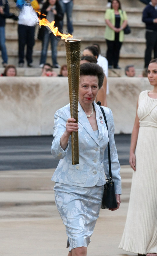 File photo dated 17/05/12 of the Princess Royal carrying the torch during the official handover ceremony of the Olympic Flame at the Panathenaic Stadium, home of the 1896 Athens Games. Anne celebrates her 70th birthday on Saturday. PA Photo. Issue date: Wednesday August 12, 2020. Anne is famed for her hardwork and no-nonsense approach to life and like the rest of the nation has been coping with life under lockdown. See PA story ROYAL Anne. Photo credit should read: Chris Radburn/PA Wire