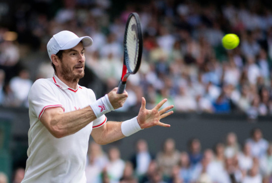 Andy Murray of Great Britain plays a forehand during his men's singles third round match against Denis Shapovalov of Canada during Day Five of The Championships - Wimbledon 2021 at All England Lawn Tennis and Croquet Club on July 02, 2021 in London, England.