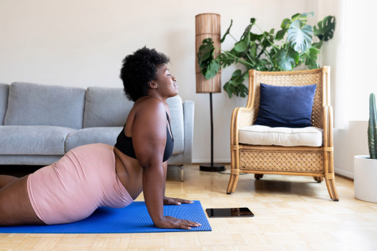 black woman working out at home