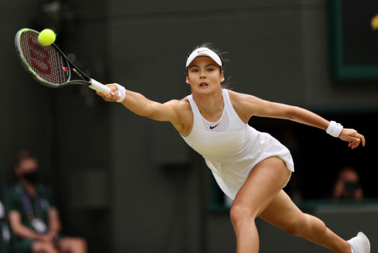 Emma Raducanu of Great Britain plays a forehand during her Ladies' Singles third Round match against Sorana Cirstea of Romania during Day Six of The Championships - Wimbledon 2021 at All England Lawn Tennis and Croquet Club on July 03, 2021 in London, England.