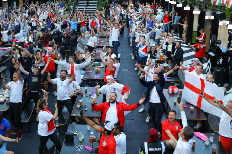 epa09321304 England supporters react as they watch a public viewing of the UEFA EURO 2020 quarter final soccer match between England and Ukraine, in Boxpark, Croydon, London, Britain, 03 July 2021. EPA/VICKIE FLORES