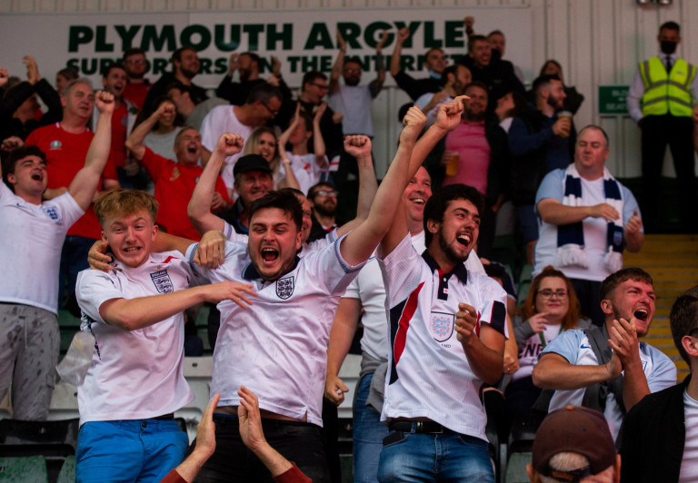 England football fans celebrate at Home Park in Plymouth, Devon. 3rd July 2021