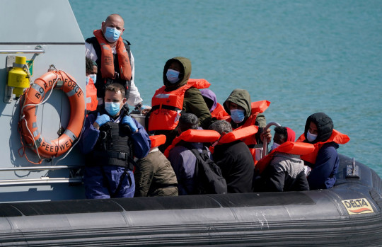 A group of people thought to be migrants are brought in to Dover, Kent, following a small boat incident in the Channel earlier this morning. Picture date: Thursday July 1, 2021. PA Photo. See PA story POLITICS Migrants. Photo credit should read: Gareth Fuller/PA Wire