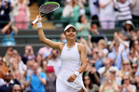 Emma Raducanu of Great Britain celebrates after victory in her Ladies' Singles third Round match against Sorana Cirstea of Romania during Day Six of The Championships - Wimbledon 2021 at All England Lawn Tennis and Croquet Club on July 03, 2021 in London, England.